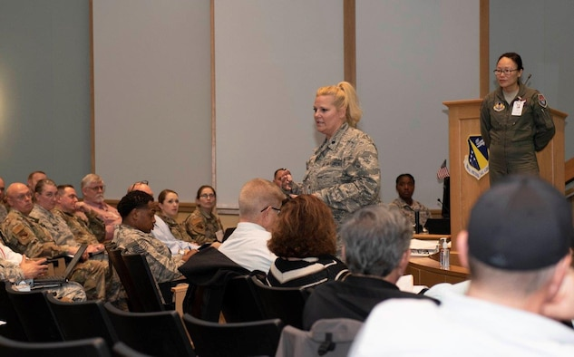 Lt. Col. Karen Kramer, 88th Aerospace Medicine Squadron's Public Health Flight commander, center, briefs the audience during a COVID-19 tabletop exercise on March 11 inside the Wright-Patterson Medical Center auditorium while Lt. Col. (Dr.) Hui Ling Li, installation public health emergency officer and 88 MDG chief of Aerospace Medicine, stands by. Li functions as the base's 'incident commander' during any public health emergency. (U.S. Air Force photo/Senior Airman Emily Rupert)