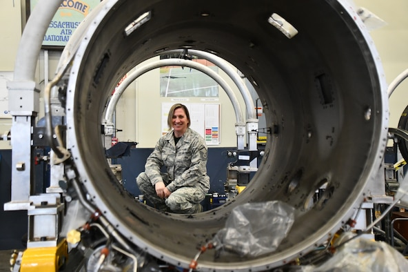 Master Sgt. Sara Jean Jacobsen, 104th Maintenance Group engine manager, looks through a F-15 Eagle engine duct, March 7, 2020, at Barnes Air National Guard Base, Massachusetts. Jacobsen enlisted at the 104th Fighter Wing over 20 years ago and said that Barnestormers strive to be the best at everything they do which leads to their success.  (U.S. National Guard Picture by Airman Basic Sara Kolinski)