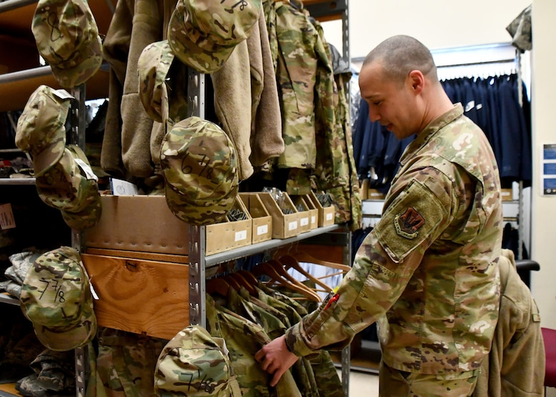 Technical Sergeant Emery McClinton, 104th Logistics Readiness Squadron material manager, sorts through jackets in retail sales, March 7, 2020, at Barnes Air National Guard Base, Massachusetts. McClinton won the 2020 state-wide non-comissioned officer of the year award. (U.S. National Guard video by Airman Basic Sara Kolinski)