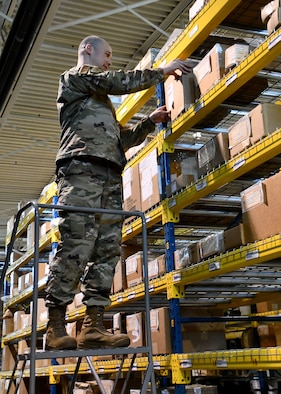 Technical Sergeant Emery McClinton, 104th Logistics Readiness Squadron material manager, inspects property in the main LRS warehouse, March 7, 2020, at Barnes Air National Guard Base, Massachusetts. McClinton won the 2020 state-wide non-comissioned officer of the year award. (U.S. National Guard video by Airman Basic Sara Kolinski)