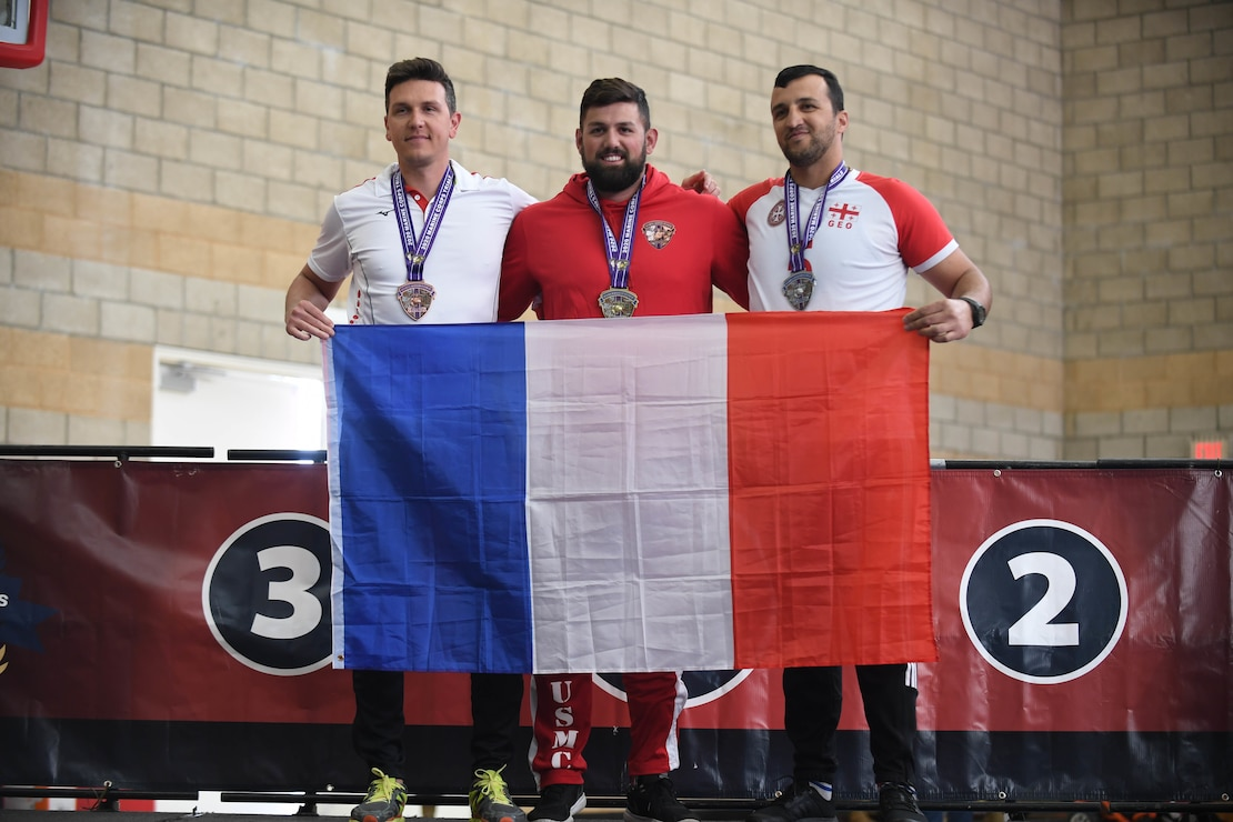 Athletes Matthieu Talliez, left, Michael Sousadecarmo, center, and Sandro Khujadze, right, win the bronze, silver, and gold medals, respectively, for the male 5.5 rowing finals during the 2020 Marine Corps Trials at Marine Corps Base Camp Pendleton, Calif., March 9.