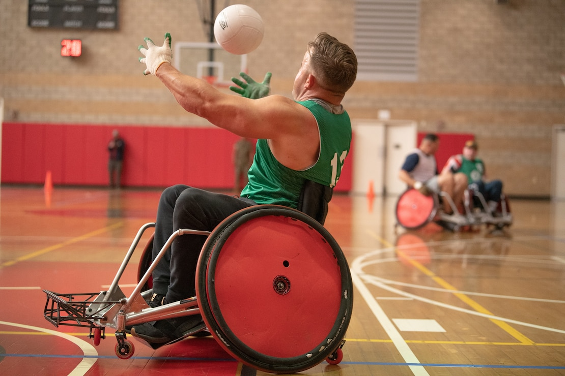U.S. Marine Corps Gunnery Sgt. Steve Mckay catches the ball during the 2020 Marine Corps Trials wheelchair rugby competition at Marine Corps Base Camp Pendleton, Calif., March 9.