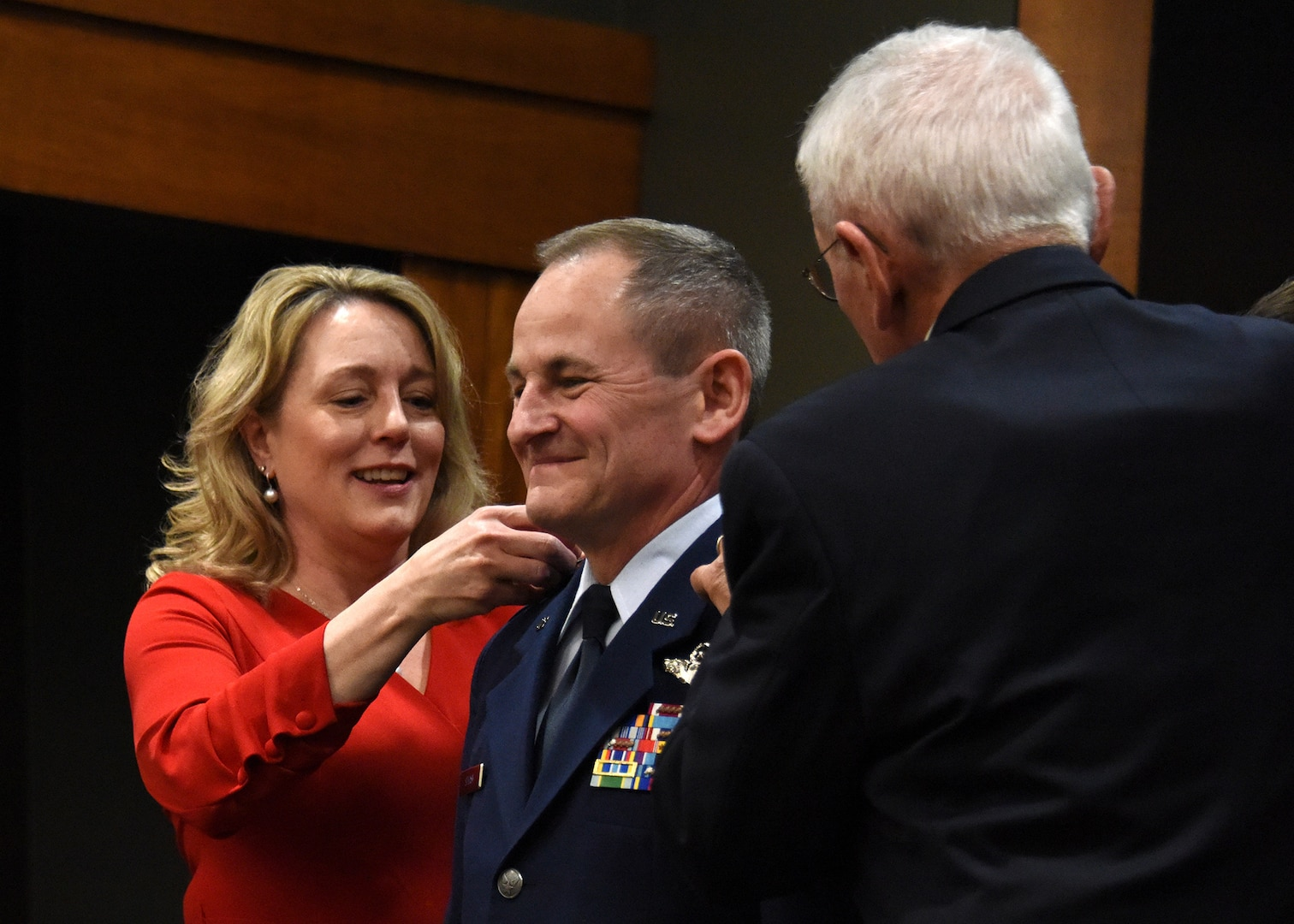 Wife, Cindy and dad, John, pin new rank on newly promoted Brig. Gen. James Silvasy, of Gurnee, Illinois, Illinois Air National Guard Chief of Staff, during a promotion ceremony March 8 at the Illinois Military Academy, Camp Lincoln, Springfield, Illinois.