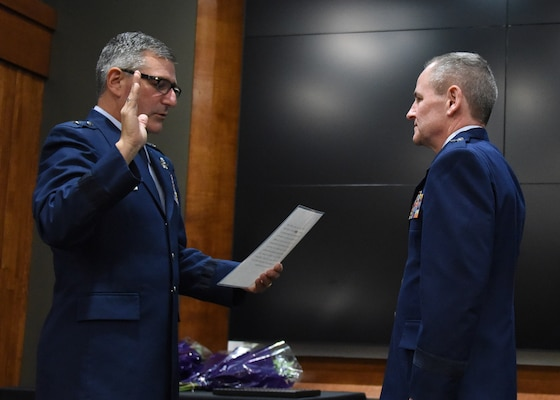 Brig. Gen. Peter Nezamis, Assistant Adjutant General-Air, Illinois National Guard, administers the oath of office to newly promoted Brig. Gen. James Silvasy, of Gurnee, Illinois, Illinois Air National Guard Chief of Staff, during a promotion ceremony March 8 at the Illinois Military Academy, Camp Lincoln, Springfield, Illinois.