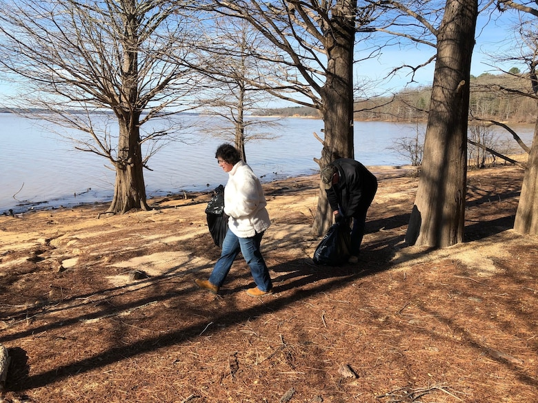 Volunteers pick up trash on Enid Lake's shoreline at the lake's annual Cleanup Day event Feb. 22.   U.S. Army Corps of Engineers (USACE) Vicksburg District park rangers, natural resources specialists and 95 volunteers removed 40 cubic yards of compacted trash and 31 tires from the lake's roads and shorelines during the event, which provides the community near the lake with the opportunity to help maintain its beauty.