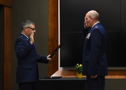 Brig. Gen. Peter Nezamis, Assistant Adjutant General-Air, Illinois National Guard, administers the oath of office to newly promoted Col. William Miller, Director of Staff-Air, Illinois Air National Guard, during a promotion ceremony March 8 at the Illinois Military Academy, Camp Lincoln, Springfield, Illinois.