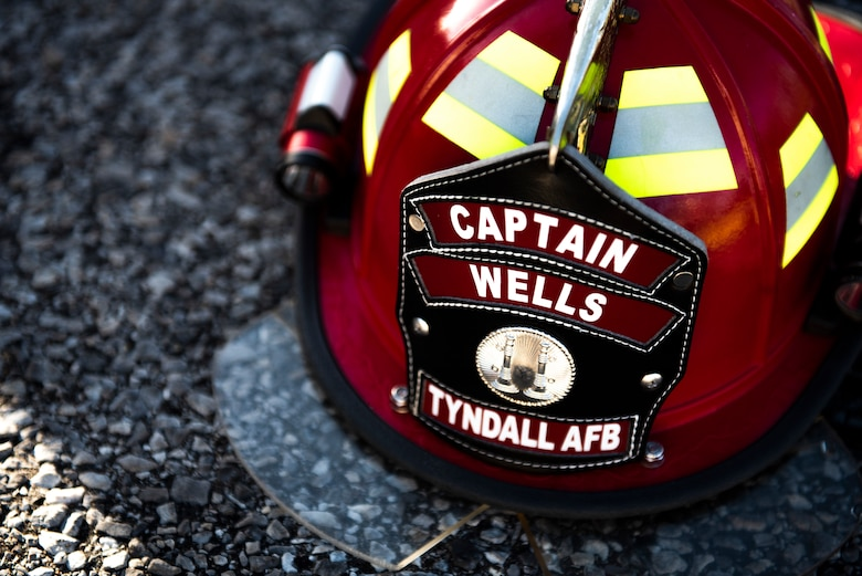 The helmet of Staff Sgt. Jeffery Wells, 325th Civil Engineer Squadron fire department member is pictured at Tyndall Air Force Base, Florida, March 12, 2020. The base participated in a joint exercise which included serval units from Tyndall and local emergency responders. The collaboration served to strengthen community relations and proper patient care during a medical emergency on base. (U.S. Air Force photo by Staff Sgt. Magen M. Reeves)