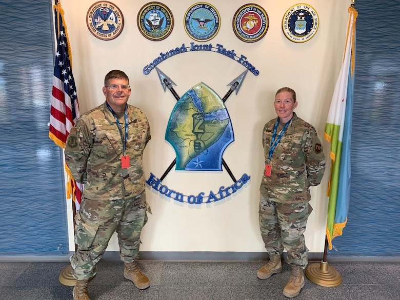 Chaplain (Maj.) John Russell and Tech. Sgt. Amy Reach, Tech. Sgt. Amy Reach, Chaplain Assistant from the 117th Air Refueling Wing, Sumpter Smith Joint National Guard Base, Birmingham, AL pose for a photo during a recent deployment. (U.S. Air National Guard photo) from the 117th Air Refueling Wing, Sumpter Smith Joint National Guard Base, Birmingham, AL pose for a photo during a recent deployment. (U.S. Air National Guard photo)
