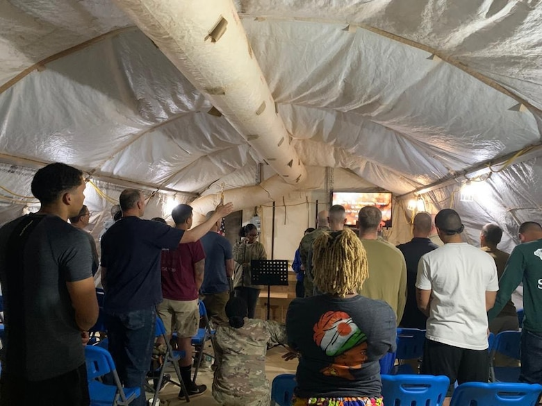 Chaplain (Maj.) John Russell from the 117th Air Refueling Wing, Sumpter Smith Joint National Guard Base, Birmingham, AL holds a worship service with troops during a recent deployment. (U.S. Air National Guard photo)
