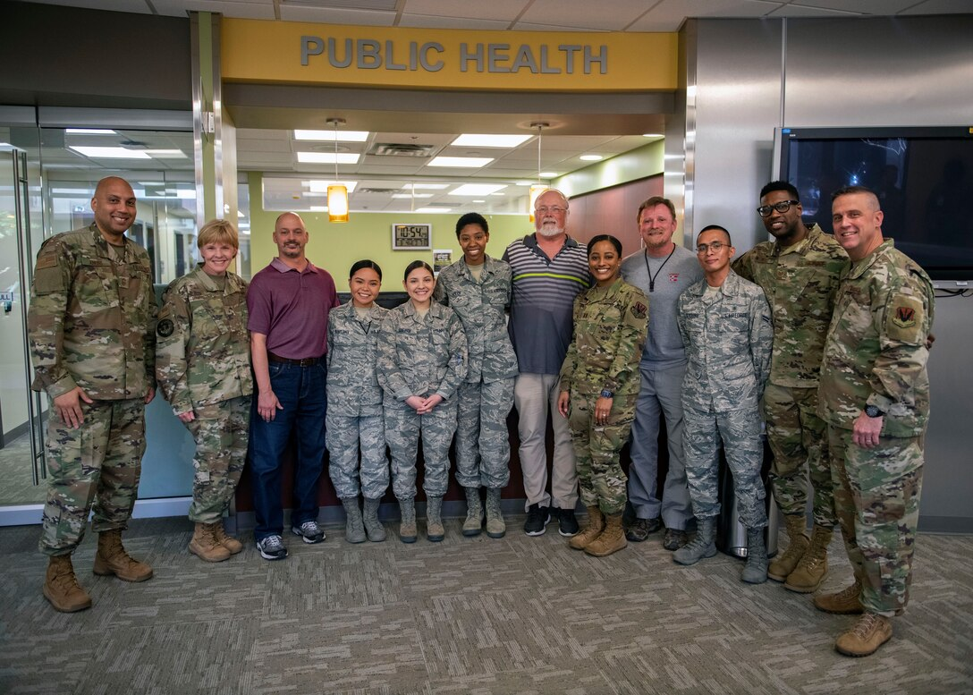 Brig. Gen. (Dr.) Sharon Bannister Air Combat Command surgeon general poses with Airmen from the 9th Operational Medical Readiness Squadron's Public Health flight.