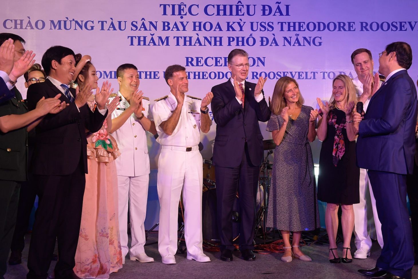 200305-N-YQ383-1154 VIETNAM (March 5, 2020) American and Vietnamese dignitaries celebrate at a reception welcoming the aircraft carrier USS Theodore Roosevelt (CVN 71) and the Ticonderoga-class guided-missile cruiser USS Bunker Hill (CG 52) to Da Nang, Vietnam, March 5, 2020. Theodore Roosevelt and Bunker Hill are in Vietnam for a port visit during their scheduled deployment to the Indo-Pacific.