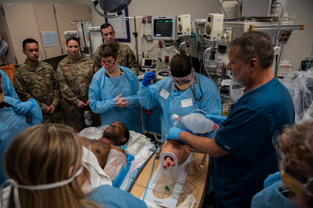 Medical technicians and nurses participate in a joint medical exercise with the 325th Medical Group at Tyndall Air Force Base and Bay County Emergency Medical Services at Ascension Sacred Heart Bay Medical Center, Panama City, Florida, March 12, 2020. The off base portion of the exercise included patient transfer from the scene of the incident by Bay County EMS to the local Ascension Sacred Heart Bay Medical Center for triage and treatment. (U.S. Air Force photo by Staff Sgt. Magen M. Reeves)
