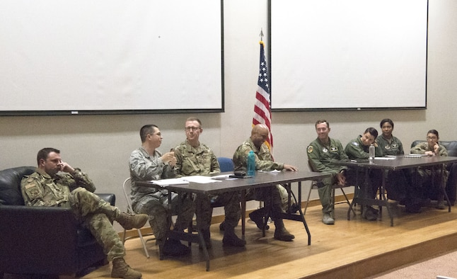 The 56th Air and Space Communications Squadron debates against the 65th Airlift Squadron about the elimination of WAPS Testing during Joint Base Pearl Harbor-Hickam's first-ever Oxford style debate Feb. 29, 2020 at the Hollister Auditorium. After 30 minutes, the 65th AS, who was in favor of eliminating WAPS Testing, was crowned victorious. (U.S. Air Force photo by 2nd Lt. Benjamin Aronson)