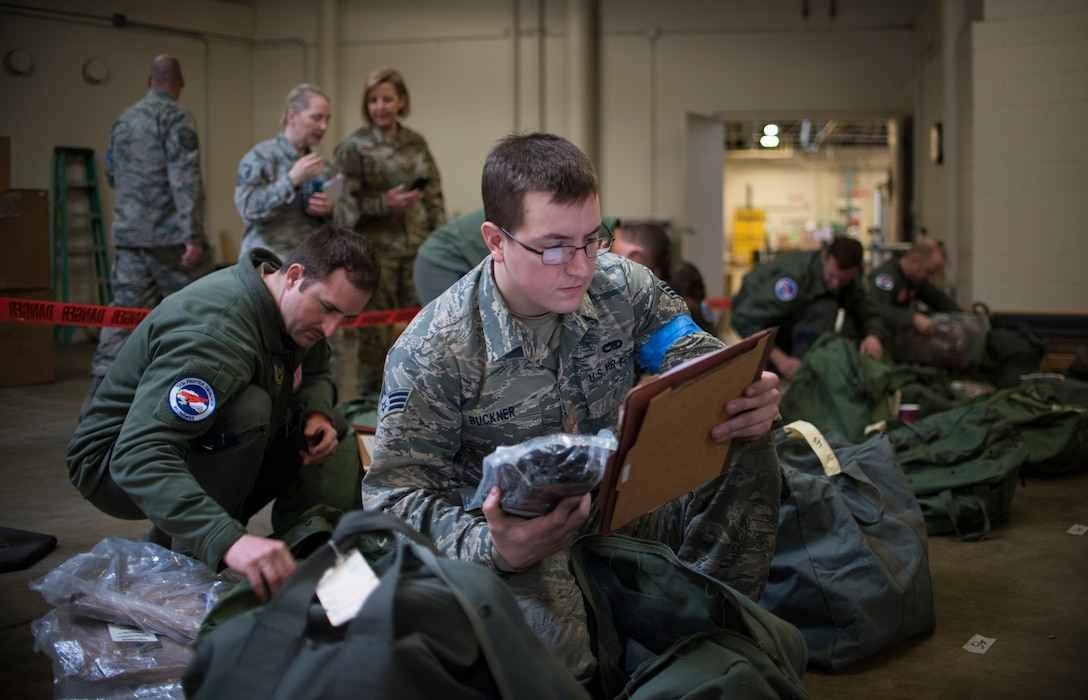 U.S. Air Force Senior Airman Brandon Buckner, assigned to the 142nd Fighter Wing's Maintenance Group, Oregon Air National Guard, reviews a packing list during deployment processing for a Combat Readiness Exercise March 7, 2020, Portland Air National Guard Base, Ore. The exercise simulated a mass deployment of approximately 700 members of the wing. (U.S. Air National Guard photo by Tech. Sgt. Steph Sawyer)
