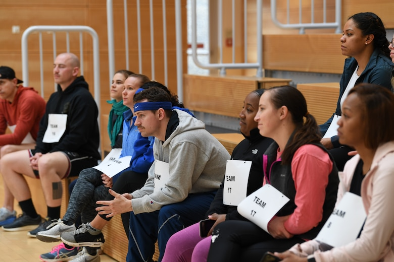 """Participants of the """"Run with Rosie"""" race listen to opening remarks provided by U.S. Air Force Col. Marlyce Roth, 52nd Mission Support Group commander, at Spangdahlem Air Base, Germany, March 12, 2020. Roth spoke on the triumphs of women throughout history and within the armed forces, and thanked participants for their service. (U.S. Air Force photo by Airman 1st Class Alison Stewart)"""