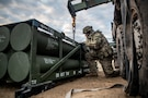 "Spc. Dylan Wiley, a multiple launch rocket system (MLRS/HIMARS) crewmember assigned to 1st Battalion, ""The Steel Warrior Battalion,"", 14th Field Artillery Regiment, 75th Field Artillery Brigade, Fort Sill, Okla., inspects rocket pods while preparing to reload an M142 High Mobility Artillery Rocket System (HIMARS) during a field training exercise on February 14, 2020, on Fort Sill. The Steel Warrior Battalion continues to train in supporting worldwide contingency as III Corps and Fort Hood only airmobile long-range precision fires capabilities. (U.S. Army photo by Sgt. Dustin D. Biven / 75th Field Artillery Brigade)"