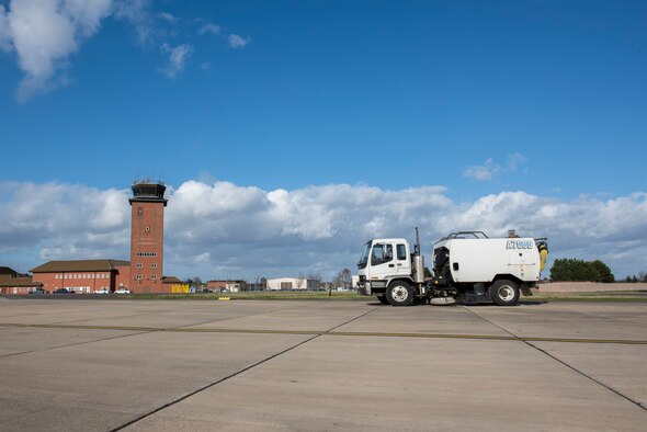 An airfield sweeper drives across the flight line March 12, 2020, at RAF Mildenhall, England. The 100th Civil Engineer Squadron pavements and construction equipment shop clears the flight line daily of foreign object debris. (U.S. Air Force photo by Airman 1st Class Joseph Barron)