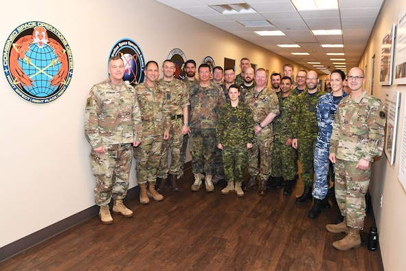 Group photo of Vandenberg leadership and multinational space personnel with U.S. Army Lieutenant General James Dickinson.