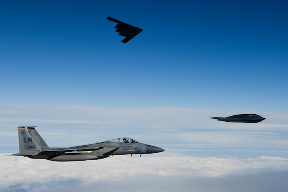 B-2A Spirit bombers assigned to the 509th Bomb Wing and an F-15C Eagle assigned to the 48th Fighter Wing conduct aerial operations in support of Bomber Task Force Europe 20-2 over the North Sea March 12, 2020. Bomber missions provide opportunities to train and work with NATO allies and theater partners in combined and joint operations and exercises. (U.S. Air Force photo/ Master Sgt. Matthew Plew)