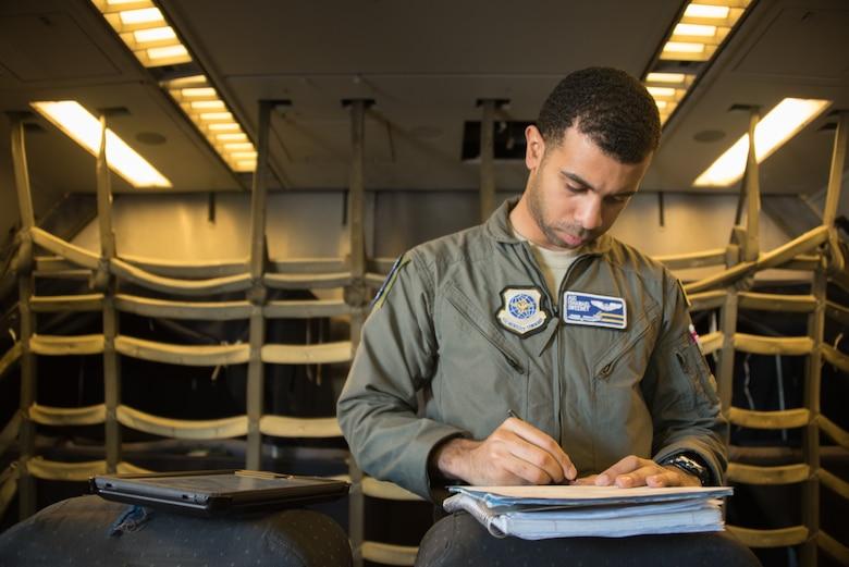 A boom operator completes his preflight checklist