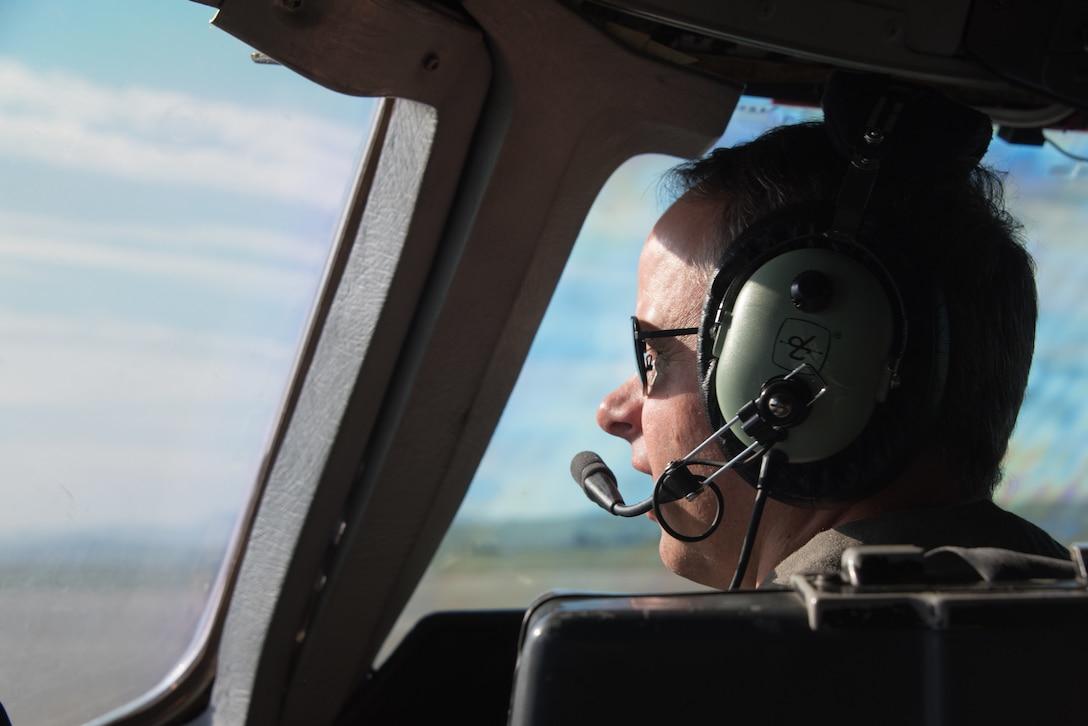 A KC-10 Extender pilot looks out the window of the flight deck
