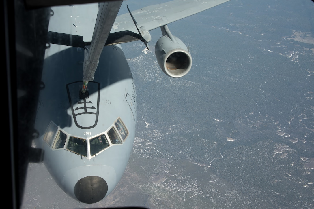 The boom of a KC-10 Extender flown by the 6th Air Refueling Squadron makes contact with a KC-10 flown by the 60th Operations Support Squadron