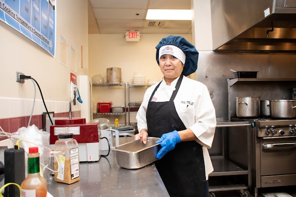 Praxedes Miller, 60th Force Support Squadron cook, prepares the lunch service March 11, 2020, at Travis Air Force Base, California. Miller has worked at the base's dining facility for 31 years. (U.S. Air Force photo by Senior Airman Christian Conrad)