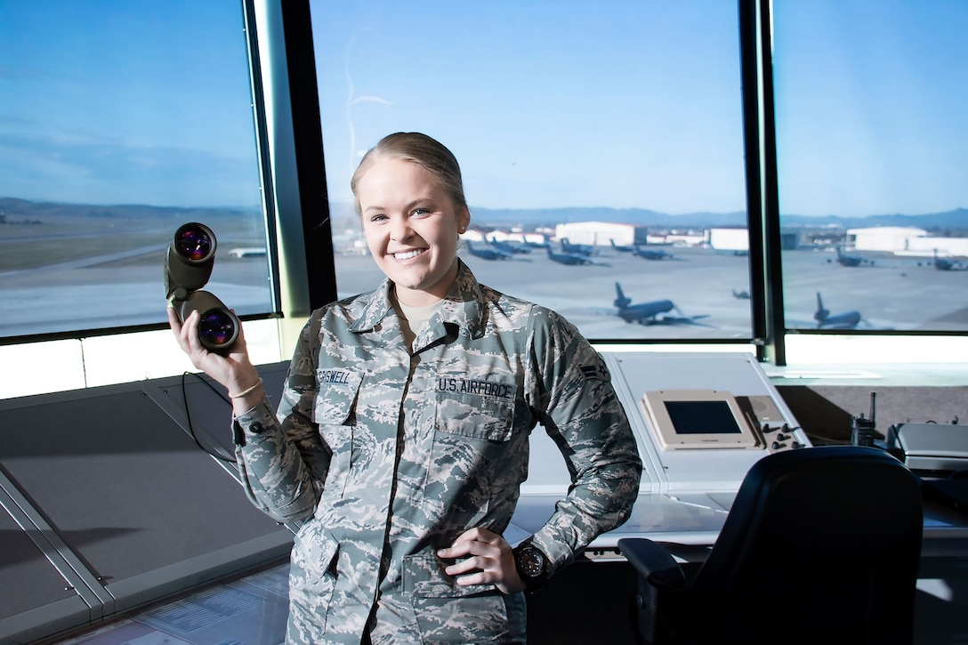 U.S. Air Force Airman 1st Class Bethany Griswell, 60th Operation Support Squadron air traffic controller apprentice, poses for a photo March 11, 2020, at Travis Air Force Base, California. The 60th OSS coordinates the take-off, landing and taxiing of Travis aircraft in a safe and expeditious manner. (U.S. Air Force photo by Senior Airman Christian Conrad)
