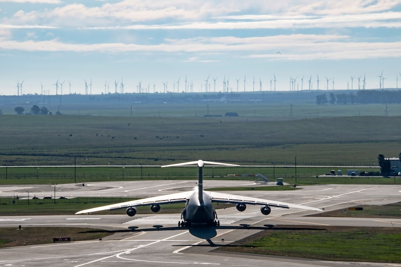 A U.S. Air Force C-5M Super Galaxy taxis onto a runway March 11, 2020, at Travis Air Force Base, California. Travis' flying squadrons perform flight missions on a daily basis to keep the skills of their pilots sharp and their aircraft in good working order. (U.S. Air Force photo by Senior Airman Christian Conrad)