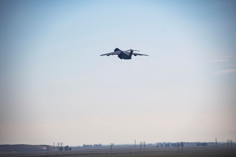 A U.S. Air Force C-5M Super Galaxy takes off during a flying mission March 11, 2020, at Travis Air Force Base, California. The C-5M is capable of reaching speeds of 579 mph and can carry over 250,000 pounds. (U.S. Air Force photo by Senior Airman Christian Conrad)