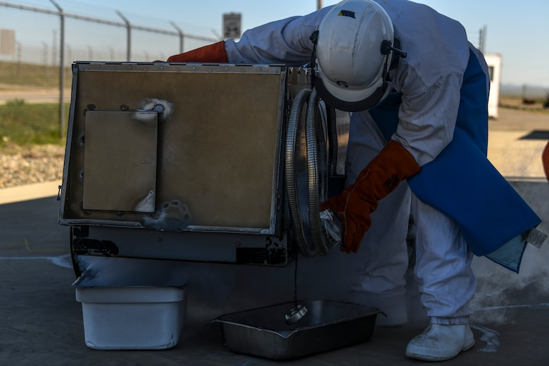 9th Logistic Readiness Squadron (LRS) fuels operators work with Liquid Oxygen