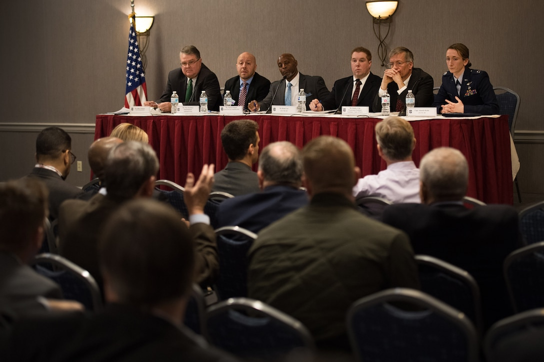 Jeffery Emmons, Small Business Office-Hanscom, from left, Peter Kontakos, Small Business Administration -Massachusetts District Office deputy district director, Charles Wingate, General Services Administration Information Technology Commodity Division branch chief,  Brian Carr, Command, Control, Communications, Intelligence and Networks Directorate Innovation director , Stanley Grip, Massachusetts Procurement Technical Assistance Center procurement specialist, and Capt. Amanda Rebhi, Program Executive Office-Digital Innovation director, take questions from the audience during the  Hanscom Small Business Panel in Newton, Mass., March 9. The panel discussed support and opportunities for small and non-traditional businesses looking to provide services to the government. (U.S. Air Force photo by Jerry Saslav)