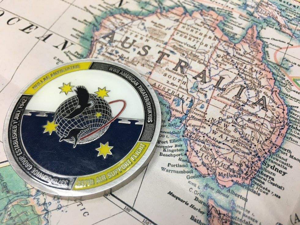 Photo of challenge coin on map