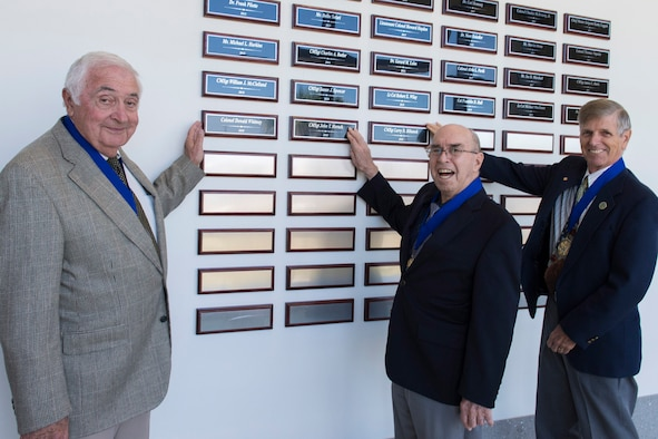 Three former members of the Air Force Technical Applications Center at Patrick AFB, Fla., were inducted into AFTAC's Wall of Honor March 11, 2020 during a ceremony held in their honor.  Pictured from left to right:  Retired Col. Donald Whitney, retired Chief Master Sgt. John T. Horsch, and retired Chief Master Sgt. Larry D. Silhanek. (U.S. Air Force photo by Matthew S. Jurgens)