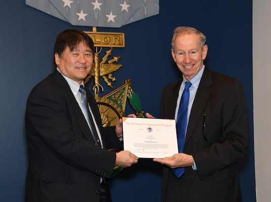 Frank Tse receives a Distinguished Service Award for his work with TTCP Weapons Technical Panel 4 from Dr. Michael Griffin, Undersecretary of Defense for Research and Engineering during the 2019 Science and Technology International Award Ceremony at the Pentagon, March 4. (U.S. Army photo by Darrell Hudson/RELEASED)