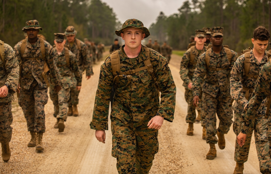 A U.S. Marine leads his squad to the first event during a field exercise, at Camp Villere, Slidell, La., March 11.