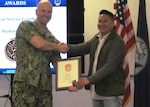 Commander shakes hands with DLA associate