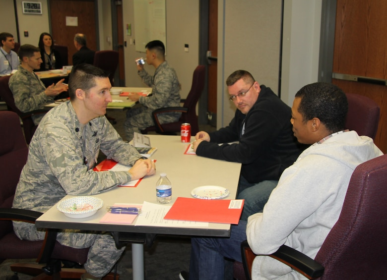 The Air Force Research Laboratory Sensors Directorate kicked off the Wright Connections Mentoring Program provided by the Sensors Directorate Learning office March 6. At the opening event, held at the Sensors Directorate Globalhawk Conference Room, mentors were matched with mentees and had the opportunity to learn a little bit about one another. Mentor Lt. Col. Michael Hethcock, Sensors Advanced Programs Branch Chief (left), and mentees Joseph Drake, and Brooklyn Bradley (right). (U.S. Air Force photo/Ted Pitts.)