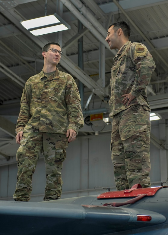 Capt. Benjamin Dickter, 4th Operations Medical Readiness Squadron mental health clinic officer in charge clinical psychologist, and Sgt. George Lopez, 4th Maintenance Group aircraft maintenance qualification program instructor, stand on top of an F-15E Strike Eagle, March 11, 2020, at Seymour Johnson Air Force Base, N.C