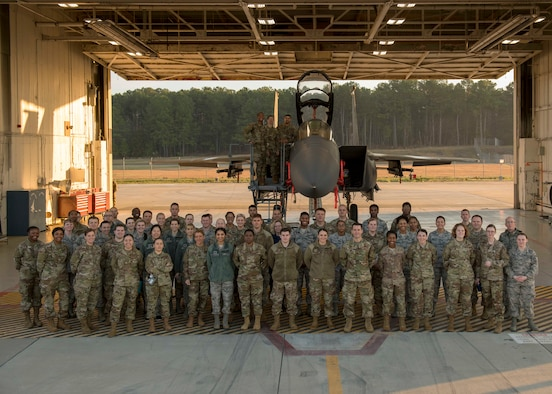 Airmen from the 4th Operations Medical Readiness Squadron pose for a photo in front of an F-15E Strike Eagle, March 11, 2020, at Seymour Johnson Air Force Base, N.C.