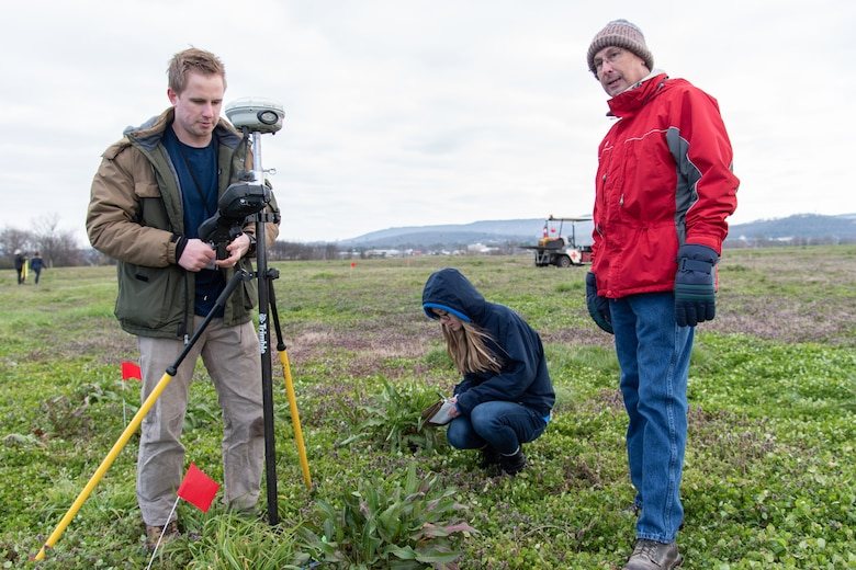 From left: Three members of the U.S. Army Engineering and Support Center, Huntsville – Benton Williams, geophysicist; Ellen Haapoja, student trainee; and William Noel, project manager – work together to plot the locations of inert munitions to evaluate the object-identification abilities of three different unmanned aircraft systems Feb. 27, 2020, at the Rocket City Radio Controllers complex in southeast Huntsville, Alabama. Williams and Haapoja work in the Geosciences Branch of the Engineering Directorate, while Noel works in the Ordnance and Explosives Design Center.
