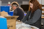 Employees from Puget Sound Naval Shipyard & Intermediate Maintenance Facility worked throughout the weekend to put together more than 2,000 cleaning kits to use around the command in an effort to amplify sanitation efforts during the COVID-19 pandemic.