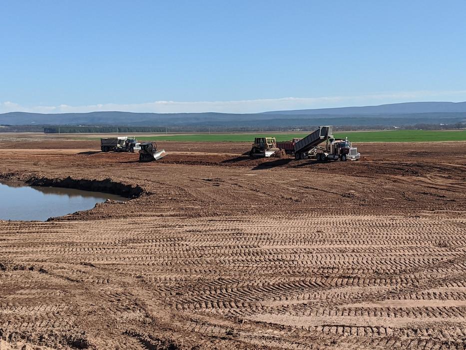 Upstream breach setback levee construction