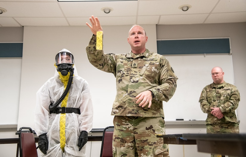 "Photo caption for attached images: Members of the West Virginia National Guard's (WVNG) Chemical, Biological, Radiological, Nuclear and High Yield Explosive (CBRNE) Battalion, 35th Civil Support Team (CST) and the 35th CBRN Enhanced Response Force Package (CERFP) provide hands-on personal protective equipment (PPE) instruction to members of first responder agencies from Kentucky and West Virginia, March 16, 2020, in Huntington, W.Va. The just-in-time training was conducted in order to educate first responders on how to minimize cross-contamination through the proper wear of, ""donning"" and the procedures for ""doffing"" PPE. (U.S. Army National Guard photo by Edwin L. Wriston)"