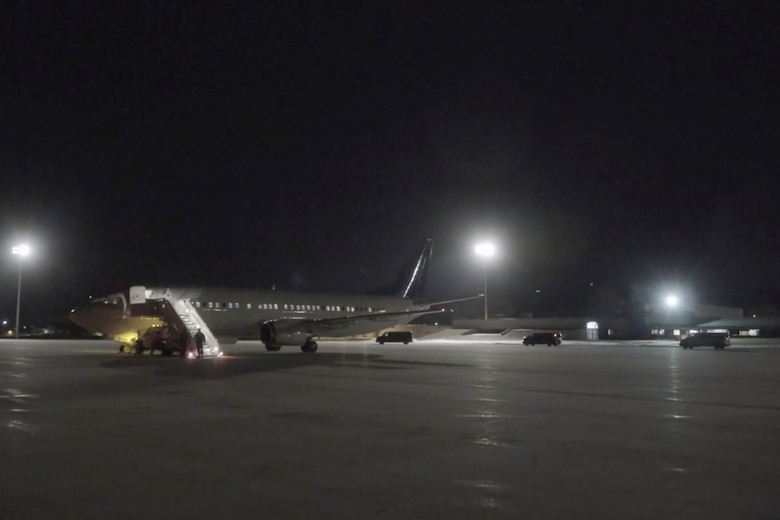 An aircraft carrying Wisconsin citizens returning from a cruise ship with confirmed cases of COVID-19 arrives at Volk Field Combat Readiness Training Center March 15. Wisconsin National Guard Soldiers and Airmen transported the residents to their homes for self-quarantine. (Video capture from Wisconsin National Guard motion media by Sgt. Alex Baum)