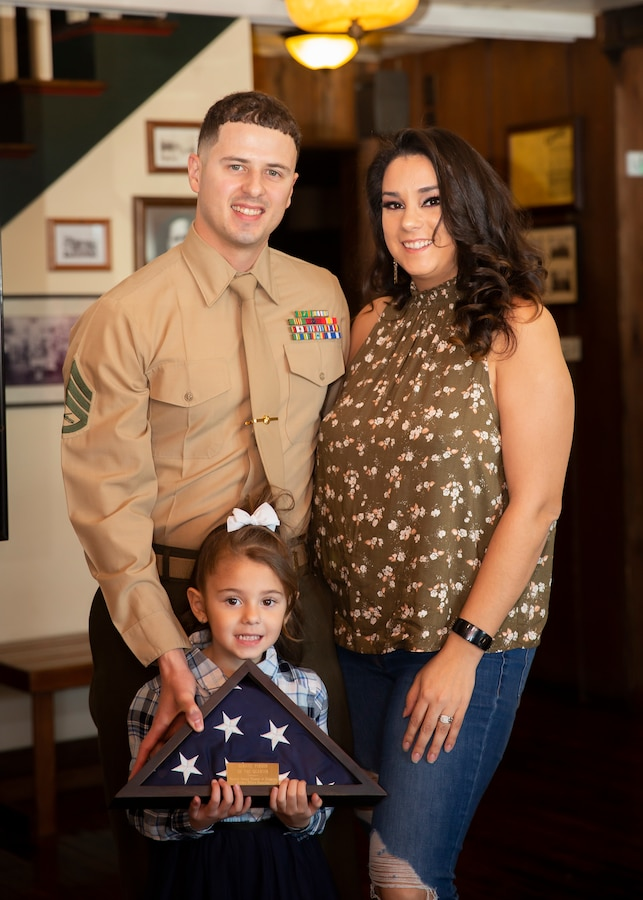 Marine Staff Sgt. Jonel Mendez poses for a photo with his wife, Shaiska, and daughter, Keilani, during a luncheon at Beaufort, North Carolina, Feb. 28, 2020. Mendez was named Service Person of the Quarter by the Carteret County Chamber of Commerce Military Affairs Committee for his outstanding volunteer service to the community. Mendez is the Alpha Company Gunnery Sergeant with Marine Wing Communications Squadron 28. (U.S. Marine Corps photo by Cpl. Cody Rowe)