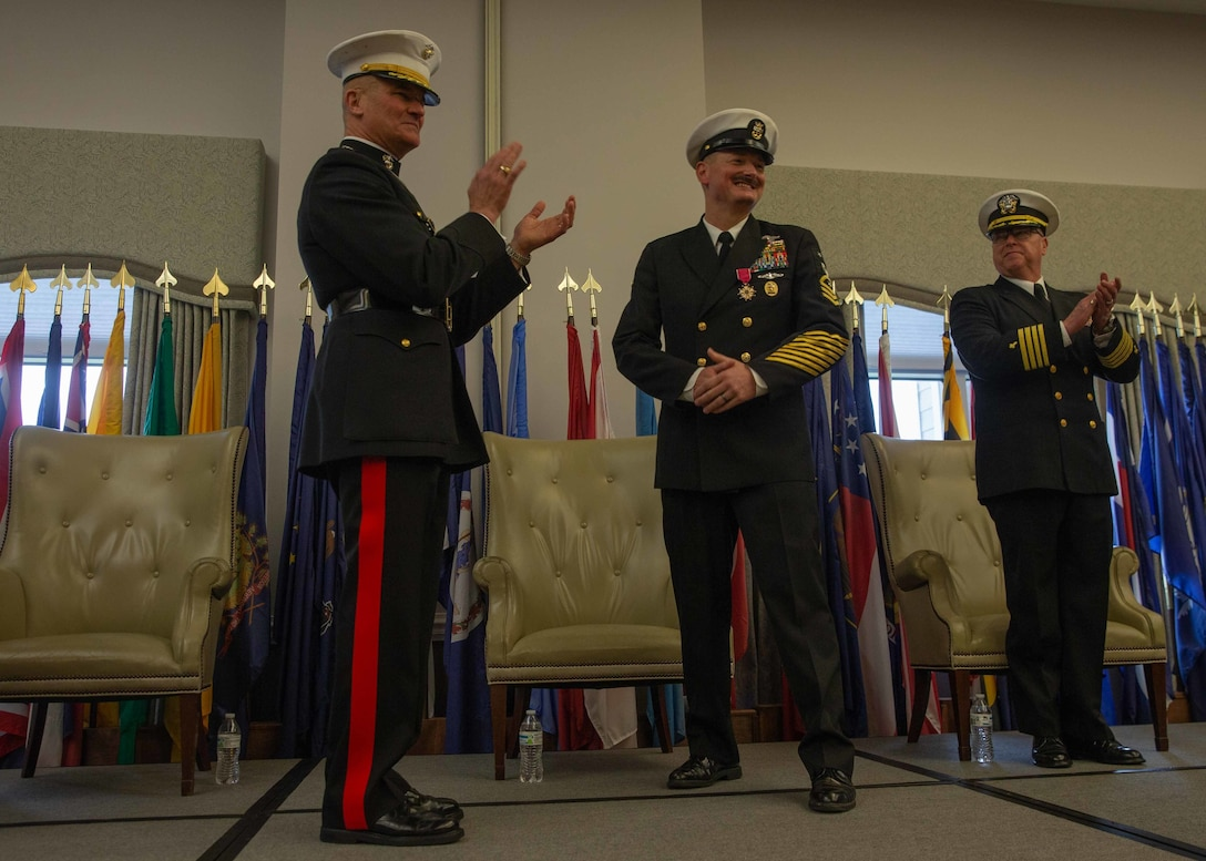 Marine Maj. Gen. Karsten S. Heckl, left, applauds after presenting the Legion of Merit award to Navy Command Master Chief Christopher L. Hill at Marine Corps Air Station Cherry Point, North Carolina, March 6, 2020. Hill retired after 32 years of faithful service to the United States Navy. Heckl is the commanding general of 2nd Marine Aircraft Wing and Hill is the outgoing Command Master Chief of 2nd MAW. (U.S. Marine Corps photo by Lance Cpl. Steven M. Walls)
