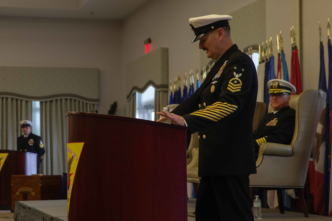 Navy Command Master Chief Christopher L. Hill speaks during his retirement ceremony at Marine Corps Air Station Cherry Point, North Carolina, March 6, 2020. Hill retired after 32 years of faithful service to the United States Navy. Hill is the outgoing Command Master Chief of 2nd Marine Aircraft Wing. (U.S. Marine Corps photo by Lance Cpl. Steven M. Walls)