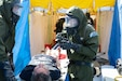 Members of the Utah National Guard Homeland Response Force's decontamination team interact with role players during a mock domestic emergency in support of the Hawaii National Guard's relief-in-place training exercise at the former Naval Air Station Barbers Point on Oahu, Hawaii, Jan. 28-30, 2020. More than 150 Utah Guard members were transported by military aircraft to Joint Base Pearl Harbor-Hickam to assist and train alongside their Hawaiian counterparts.