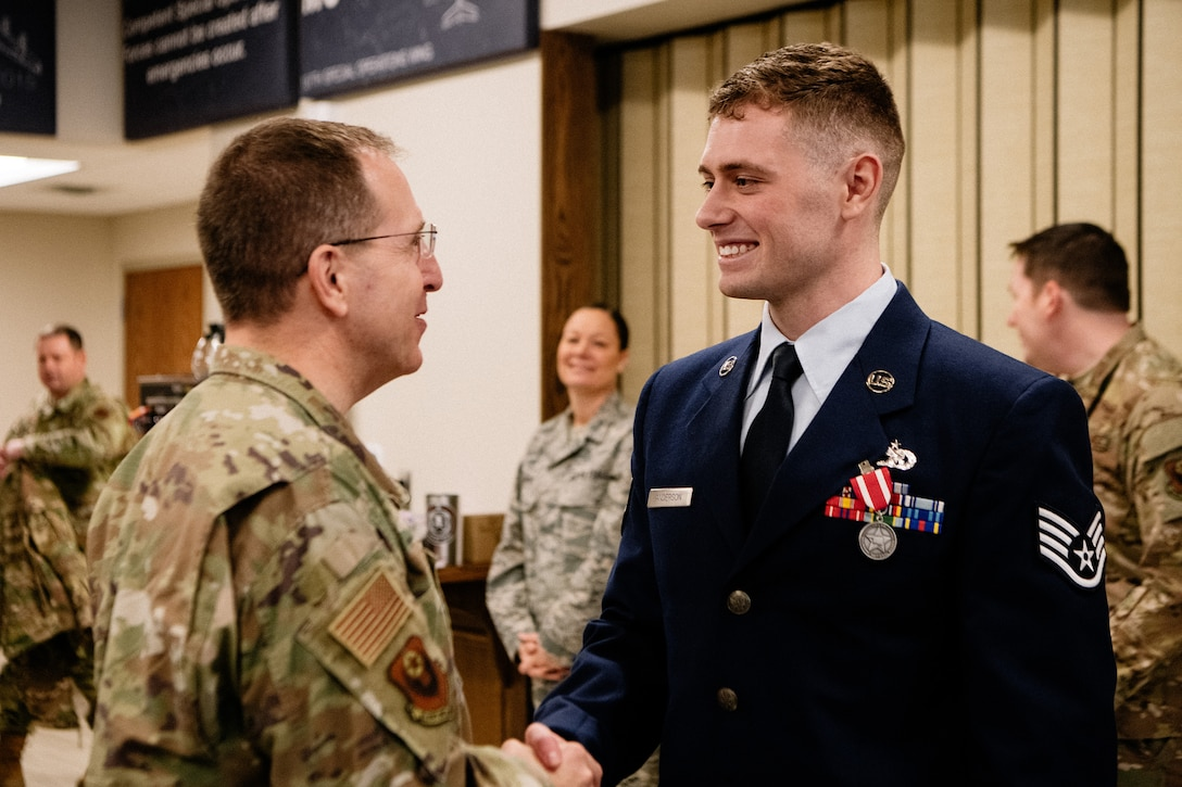 Staff Sgt. Benjamin Anderson, an air freight journeyman assigned to the 137th Special Operations Logistics Readiness Squadron, shakes hands with distinguished guest U.S. Air Force Lt. Gen. Jim Slife, commander of Air Force Special Operations Command, after an Oklahoma Star of Valor ceremony March 7, 2020, at Will Rogers Air National Guard Base, Oklahoma City. Slife was among many distinguished guests and attendees present at the ceremony honoring the heroic actions of Anderson.